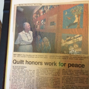 Elise Boulding with Peace Quilt made for her.